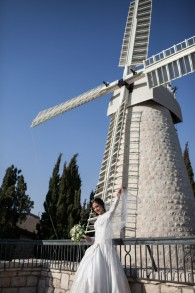 One lucky bride is photographed in front of the restored windmill (photo credit: Noam Moskowitz/Flash 90)
